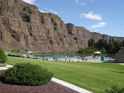 The large pool and cloverleaf spa are located down close to the river.